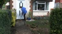 Ruislip resident clears up after flooding