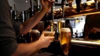 A barman pulling pints