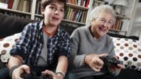 Boy and grandma playing video game