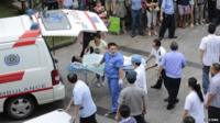 Man injured in Kunshan factory explosion being put into ambulance