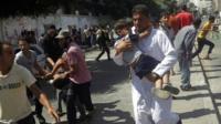 Children are carried from the site of the Rafah attack, 3 Aug