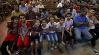 Iraqi Christians who fled Qaraqosh in a church in Erbil