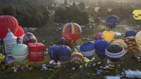 Hot air balloons depart from Aston Court in a mass ascent on the first full day of the Bristol International Balloon Fiesta on August 8, 2014