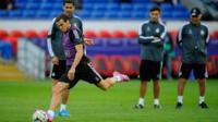 Gareth Bale practices shooting at the Cardiff City Stadium