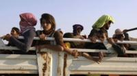 Displaced people from the minority Yazidi sect, fleeing the violence in the Iraqi town of Sinjar