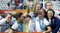 England's players celebrate with the Rugby World Cup trophy