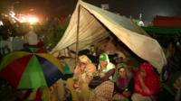 Protesters taking shelter in a makeshift tent outside Pakistan's parliament