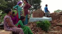 People by collapsed building