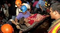 Rescued Nicaraguan gold miner carried on a stretcher