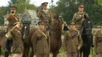 People marching in WW1 army uniform