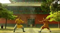Two monks at Shaolin Buddhist Temple doing Kung Fu