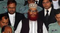 Jamaat-e-Islami leader Delwar Hossain Sayeedi (C) emerges from the Bangladesh International Crimes Tribunal in Dhaka on August 18, 2011.