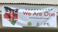 Banner reading 'We are one' with the map of Kenya in colours of the Kenyan flag