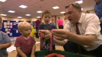 Ed Balls on a school visit playing with play dough with children