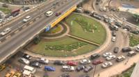 Lots of cars on a roundabout