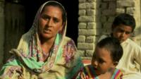Woman and her children in Pakistan