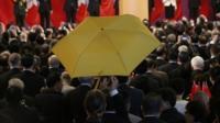 Paul Zimmerman raises umbrella