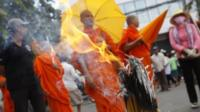 Buddhist monks and other protesters gather near the Vietnamese embassy
