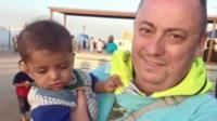 Alan Henning with child