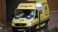 An ambulance crew is parked outside the entrance of the apartment building of the nurse who contracted Ebola, in Alcorcon, outside Madrid, October 8, 2014