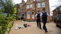Police at scene where children were found
