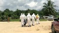 Team prepare to remove an Ebola infected body in Monrovia