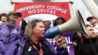 NHS workers gather to strike outside hospital