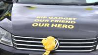 Car with tribute to Alan Henning and yellow ribbon