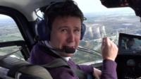 BBC reporter Jon Kay above Didcot power station