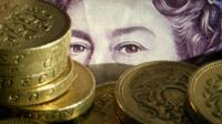 Pound coins and note