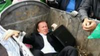 Politician in waste bin
