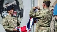 The last Union flag of Great Britain flying above the skies of Helmand Province, Afghanistan, is lowered