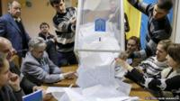 Ballot papers being tipped out of a box ready for counting following Ukraine's parliamentary election on 26 October 2014