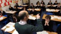 Teacher speaking to class of pupils