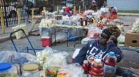 Women selling food at Liberian market in Clifton neighbourhood of Staten Island