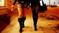 Two women working as prostitutes walking down the street