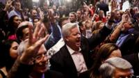 """Daryl Johnson, centre, screams, """"Four more years,"""" for Gov. Rick Scott along with the crowd of supporters as they watch the election results at the Hyatt Regency Coconut Point in Bonita Springs, FL 4 November 2014"""