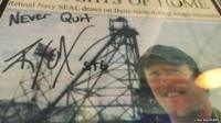 Close up of signed newspaper poster with picture of ex-Navy Seal Robert O'Neill