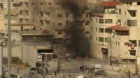 Black smoke from burning dumpster in Jerusalem