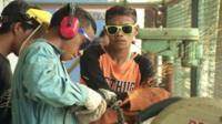Young boys working with metal