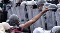 Protesters and riot police