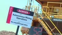 Warning sign about autonomous mining operations