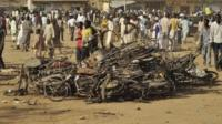 People at the site of a bomb explosion in Kano
