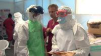 Doctors in protective clothing