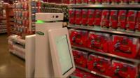 Retail robot moving across shop floor
