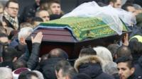 Tugce Albayrak's coffin is carried through crowds of mourners