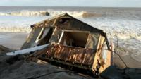 The scene where properties have fallen into the sea due to a cliff collapsing on December 6, 2013 in Hemsby, England