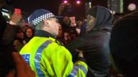 Policeman and protester outside Westfield Shopping Centre, London
