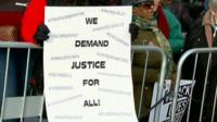 Placard reading 'We demand justice for all'