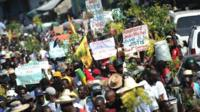 Demonstrators march during a protest against the government of President Michel Martelly in Port-au-Prince, on December 12, 2014